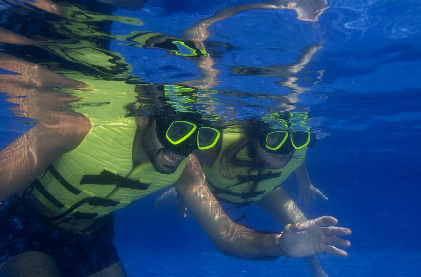 Couple using water visors underwater