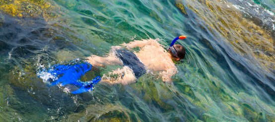 Man snorkeling in blue sea of Cancun